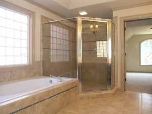 Get rid of that flimsy, outdated laminate tile and upgrade with gorgeous porcelain tile instead!  This bathroom features all new porcelain tile on the floor, around the tub and in the shower stall.
