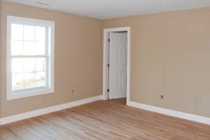 Homeworx pro offers new home construction services. Bedroom in new construction home. Drywall, flooring, baseboard, door hanging and painting.