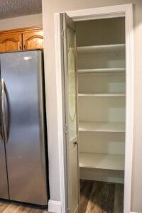 wood shelves in pantry